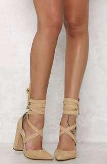 Pointed-toe nude pumps