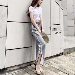 "🚚 🇰🇷NEW ARRIVAL🇰🇷 2-piece set, crop top, cross-waist design Shape Put on a pair of pants. Both ends of the leg cut 2 colors, black and white Freesize ... T-shirt 34-38 ""long 16"" pants... Waist 22-38 "" Hips 42-46 "" Length 34 """