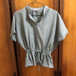 Grey top with ruffle