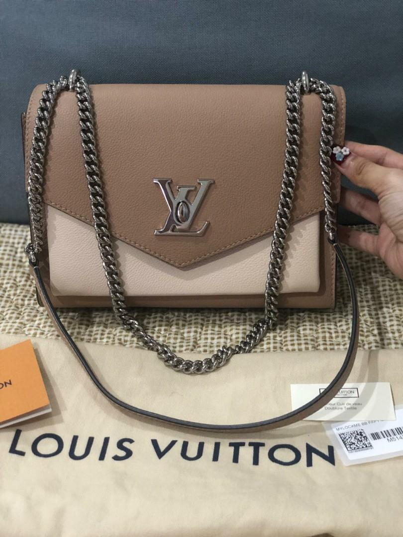 Reprice ...Used Once Like new LOUIS VUITTON mylockme BB leather in papyrus creme SHW. Comes with dustbag, booklet. selling