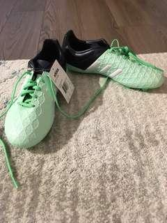 Brand new Adidas outdoor  soccer shoes