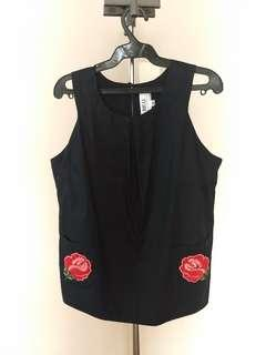 Sleeveless Top with Rose Accent