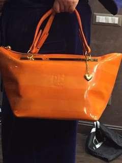 Patent leather orange purse by Ph+39 Italia