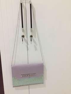 Envelope sling bag