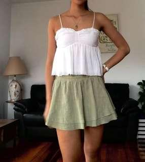 White linen top with raw hem
