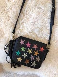 Black leather star detailing satchel