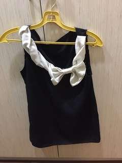 Sleeveless black & white top
