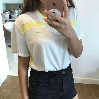 retro nike white and yellow dryfit tee