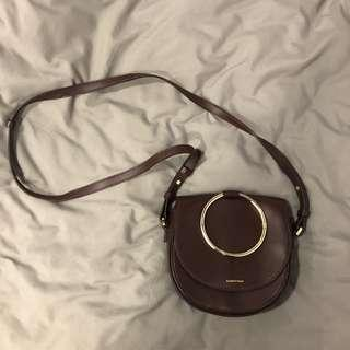 brown leather ring sling bag
