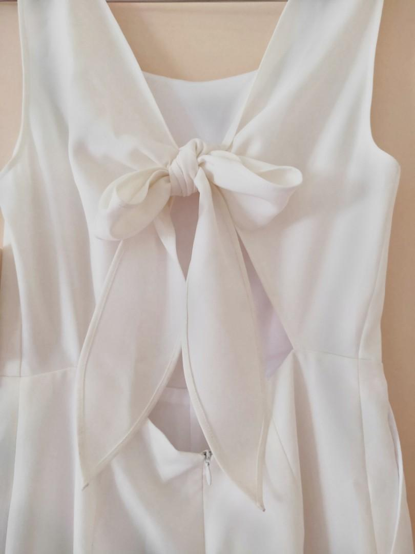 white jumpsuit with a bow that you can tie BRAND NEW