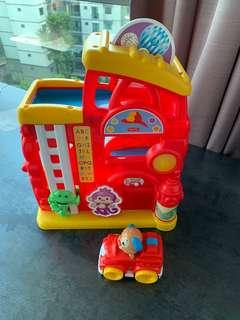 Fisher Price Toy fire station with drop down car