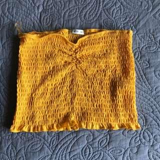 Size M yellow strapless top
