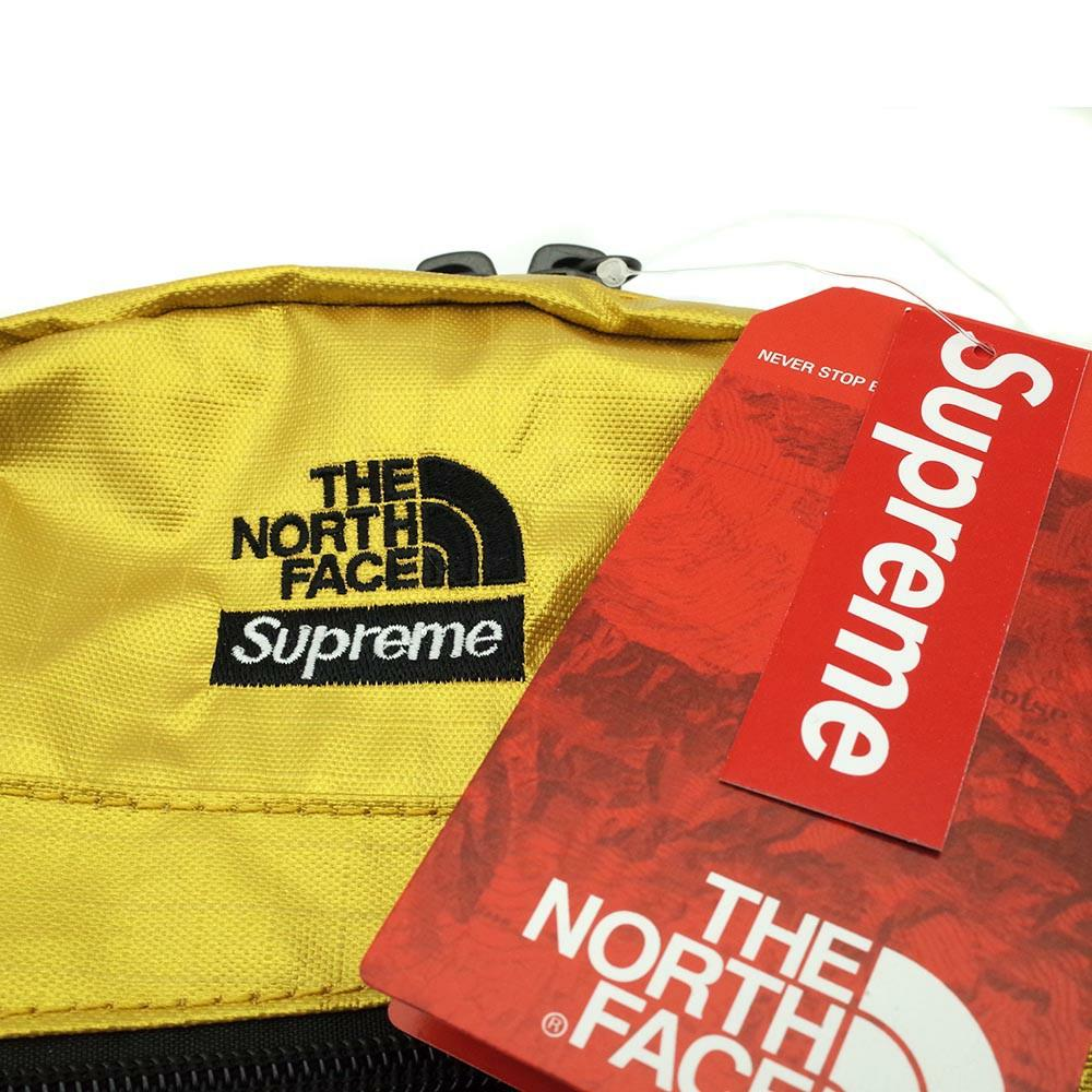 Supreme x TNF metallic shoulder bag gold