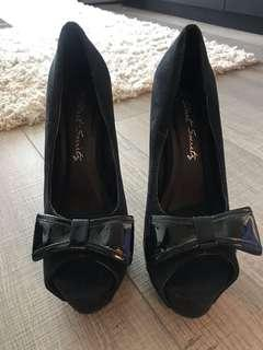 Black suede plate form heels with bow