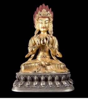 Buddha seated on a lotus