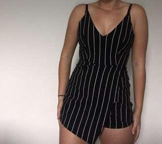 Black and white striped jump suit