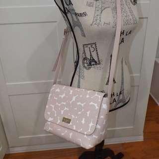 Putnam Drive splodge dot pink multi sling bag
