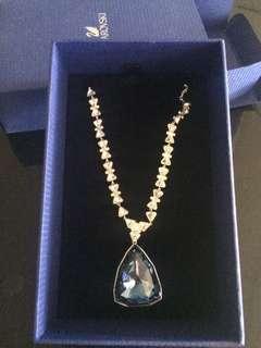 Swarovski Silver-colored framed blue gemstone encrusted pendant necklace