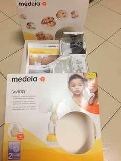 Medela Swing pump with Calma