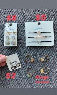 Ear rings, rings and wristbands