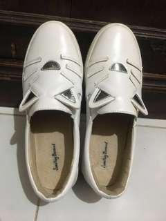 White cat shoes