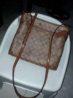 Authentic coach sling file