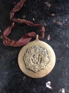 🚚 Tibetan Om Symbol Pendant