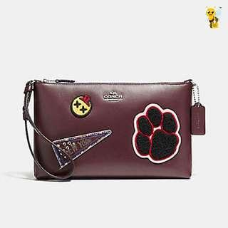 Coach Large Wristlet 25 IN Refined Calf Leather with Varsity Pacthes. 60% OFF Clearance Sales original price: MYR590!