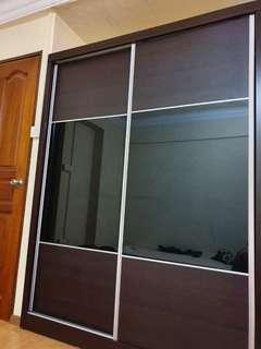 Solid wood exterior sliding wardrobe with dark glass panels