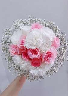 Roses, Carnation and eustomas bridal bouquet