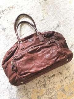 🚚 PRADA leather duffle bag.