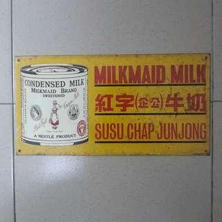 "Vintage Milkmaid Milk Sign. Approx.12""×6""."