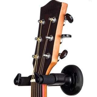 Guitar wall hanger holder