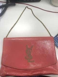 YSL Clutch in pink with chain