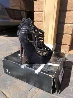 Zu Cut Out Wedge Platform Black Heel 6