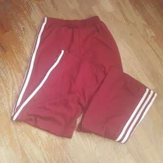 red/ maroon pants with 3 stripes