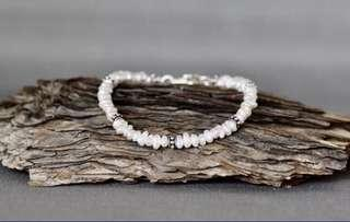Pretty Irregular  white freshwater pearls on a silver clasp.