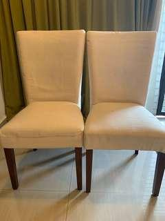 Two wooden (legs) dining chairs