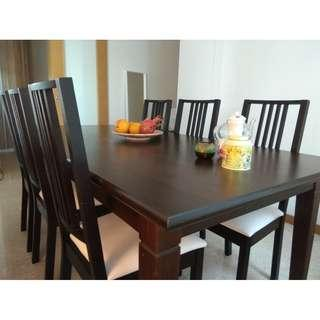Black brown dinner table with six matching chairs