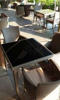 🚚 Brown Rattan Table with Black Glass Top