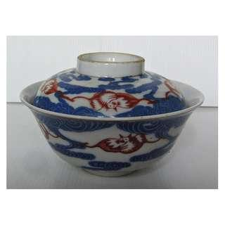 Japanese transferware cover bowl with red bats and blue cloud.