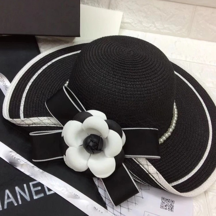 738fddb65ad84 Classic black and white color matching cuffed pearl flowers big hat ...