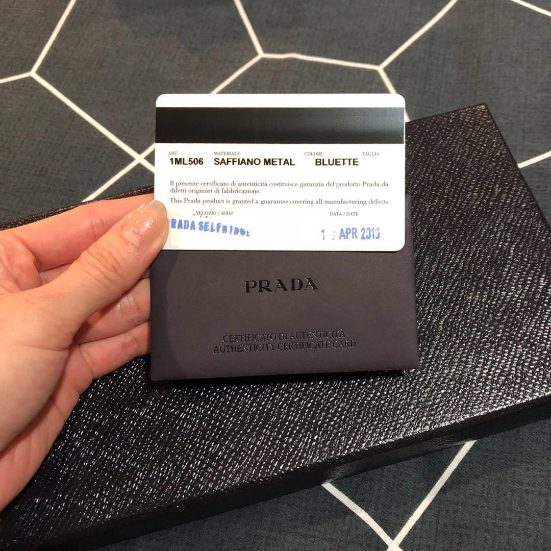 bebb89ff76d4 Pre-Loved Authentic Prada Saffiano Metal Long Zip Around Wallet, Luxury,  Bags & Wallets, Wallets on Carousell