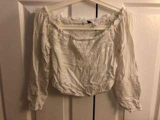 White off-shoulder crop top with pattern
