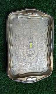 Antique brass plate with carving