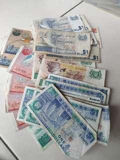 Assorted circulated singapore notes