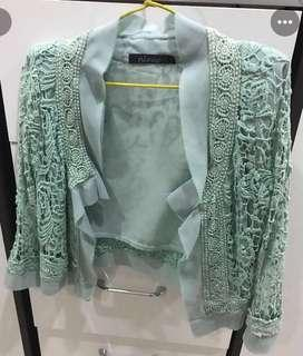 Pastel green lace outerwear from Australia