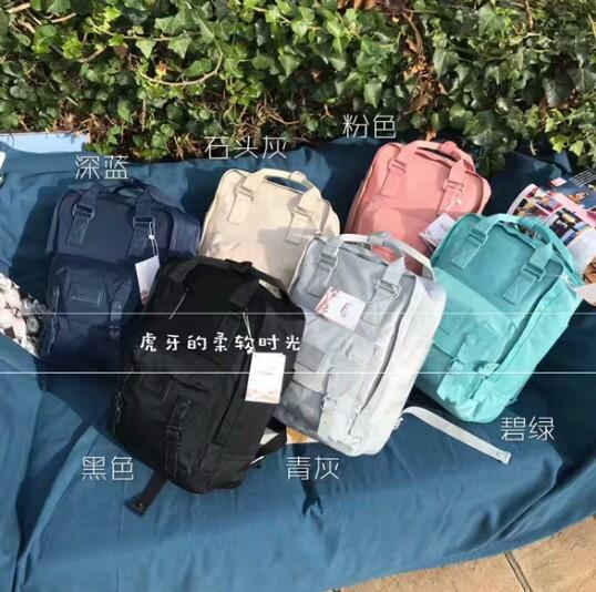 Small red book Lin Yun with the paragraph winter donut stone color solid color large capacity waterproof shoulder student  backpack