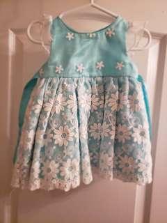 Light blue flowered dress for baby