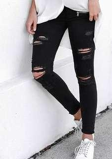 Skinny black ripped jeans